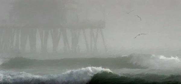 Fog envelopes the pier at Huntington Beach, California