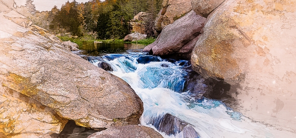 Water flows between massive boulders in the Eleven Mile Canyon in Colorado