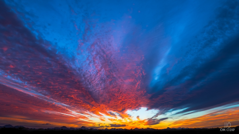 God weaves intense colors into a sunset as seen from Scottsdale, Arizona